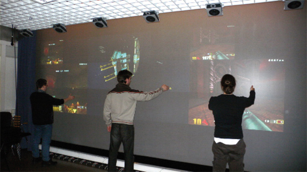 Gesture-Based, Touch-Free Multi-User Gaming on Wall-Sized